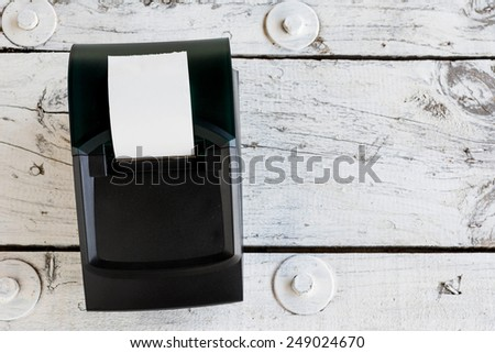 bar code printer on wooden table ready for working - stock photo