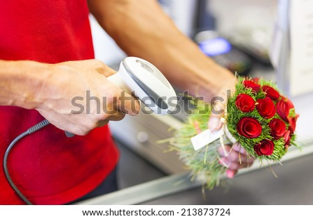 bar code scanner and rose bouquet - stock photo