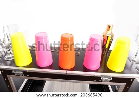 Bar counter with different glasses and shakers on it. Isolated on the white background - stock photo