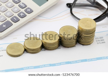 bar graph of Gold coins on paper business documents,concept of investment and profitability in business.