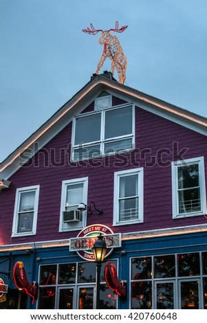 BAR HARBOR - JULY 9: Famous Geddy`s Pub in down town  on July 9, 2013 in Bar Harbor, Maine.. - stock photo