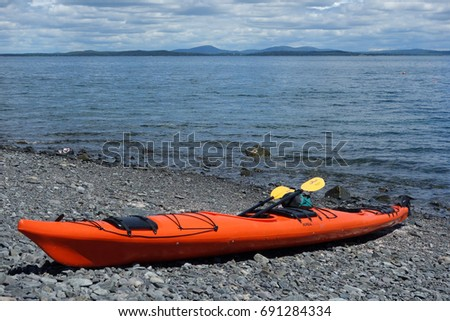 BAR HARBOR, MAINE - JULY 4, 2017: Sea kayaks on a rocky beach in Bar Harbor. Bar Harbor is a famous summer colony in the Down East region of Maine