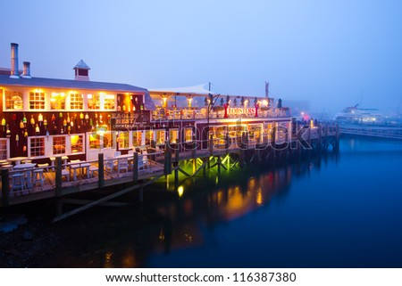BAR HARBOR, ME - JULY 24:  Dockside lobster restaurant in historic Bar Harbor ME on night of July 24, 2011. Bar Harbor is a famous location in Down East Maine with a long history of lobstering. - stock photo