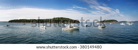 Bar Harbor panorama, showing small fishing boats anchored in the bay. Maine, USA - stock photo