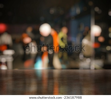 bar in a night club near dancefloor - stock photo