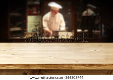 bar interior with chef of kitchen and single top  - stock photo