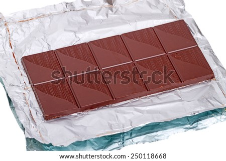 Bar of chocolate on a foil isolated on white background - stock photo
