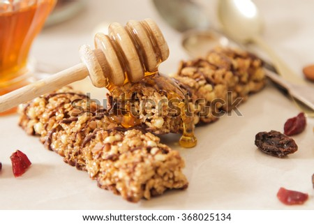 bar of delicious muesli with honey and nuts easy nutritious breakfast.  - stock photo