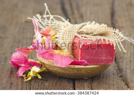 bar of natural soap and tulip flower - stock photo
