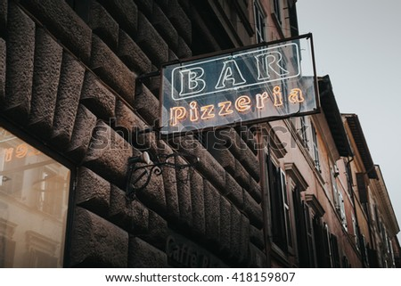 Bar Pizzeria lettering in Rome, Italy.