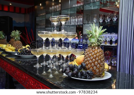 Bar.  pyramid from glasses and fruit.