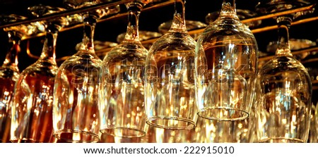 Bar room hanging glasses interior view. - stock photo