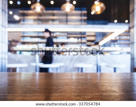 Bar table top Restaurant Interior with people background  - stock photo