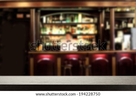bar with waiter and dark free space  - stock photo