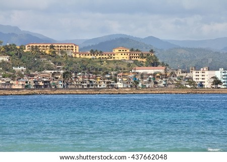 Baracoa, Cuba - coastal view of the town and the Caribbean Sea - stock photo