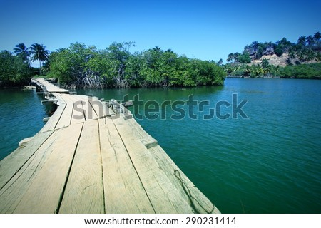 Baracoa, Cuba - Rio Miel bridge, part of Alejandro de Humboldt National Park. Filtered colors. - stock photo