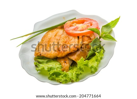 Baracuda steak with sauce and salad
