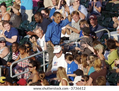 Barak Obama Waving at the Ballgame - stock photo
