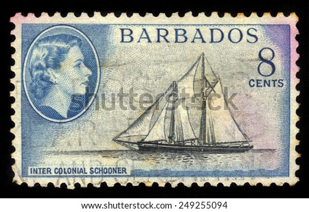 BARBADOS - CIRCA 1954: A stamp printed in Barbados shows inter colonial schooner and portrait of Queen Elizabeth II, circa 1954 - stock photo