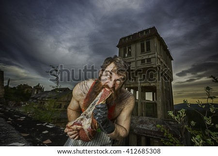 Barbarian eat raw meat with damaged building