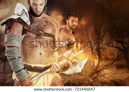 Barbarian warriors in a burned forest ready to battle