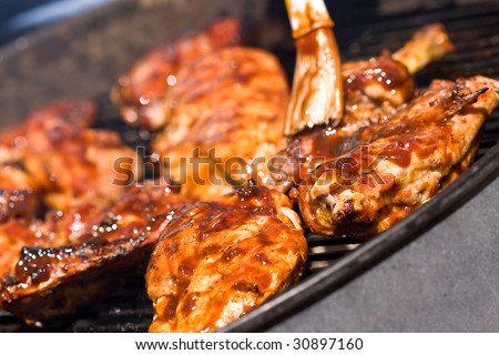 barbecue chicken on the grill with sauce - stock photo