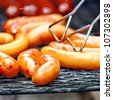 Barbecue. Close-up of grilled sausages on wire rack - stock photo