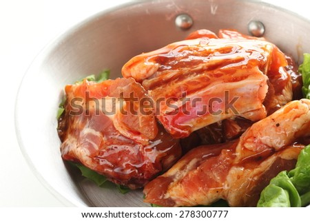 Barbecue cooking, marinated pork spareribs on stainless pan for camping food image in diorama style