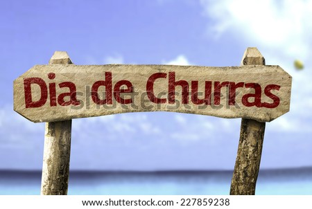 Barbecue Day (In Portuguese) wooden sign with a beach on background - stock photo