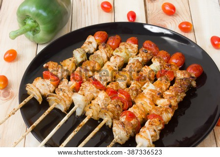 Barbecue grill seasoned meat with vegetables on skewers
