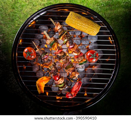 Barbecue grill with various kinds of meat. - stock photo