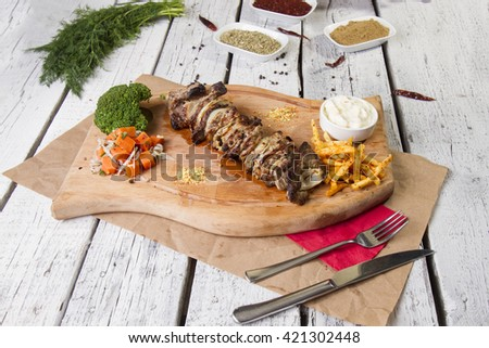 Barbecue, grilled meat on wood table, saslik - stock photo