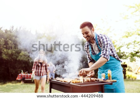 Barbecue in nature being done by friends
