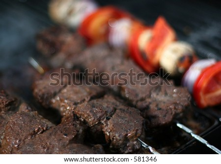 Barbecue meat and vegetables on sticks - stock photo