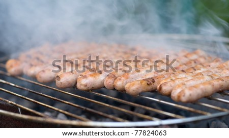 barbecue - Munich sausages on the chargrill - stock photo