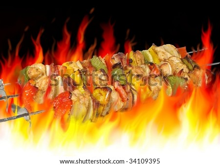 barbecue on background of flames - stock photo