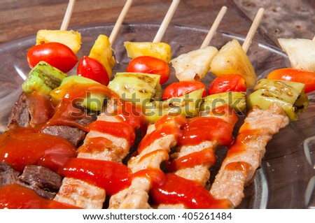 Barbecue on wooden table. - stock photo