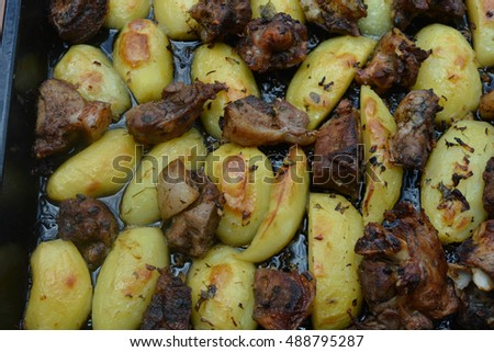 Barbecue, roast potatoes, onions, vegetables