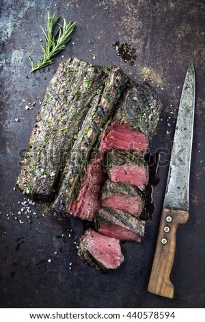 Barbecue Saddle of Venison on Metal Sheet - stock photo