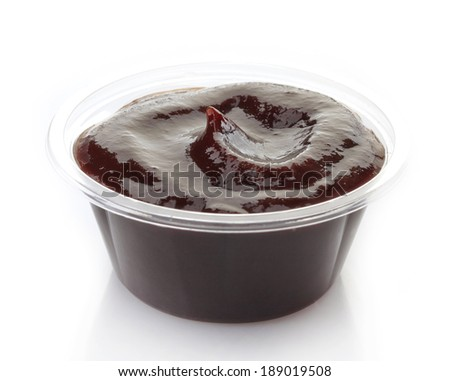 Barbecue sauce in a plastic take away container - stock photo