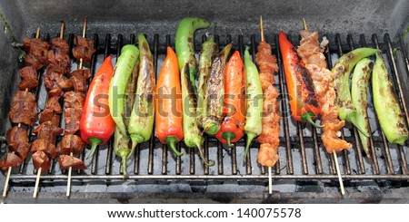 Barbecue. Shish kebab and grilled peppers on hot grill - stock photo