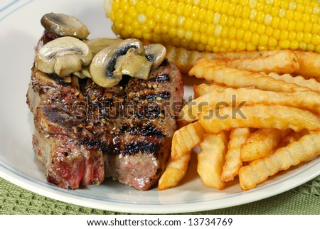 barbecue short ribs with french fries and vegetables
