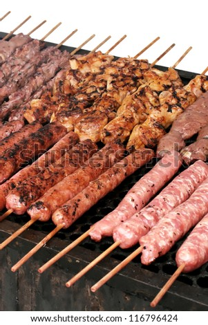 Barbecue skewers on the grill - stock photo