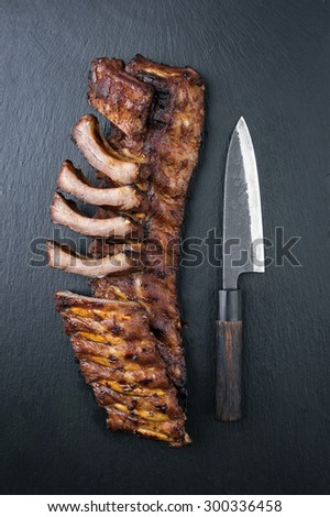 Barbecue Spare Ribs on Black Background - stock photo