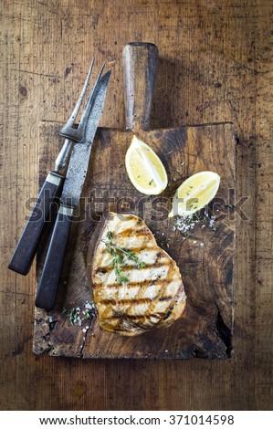 Barbecue Swordfish Steak on Cutting Board - stock photo