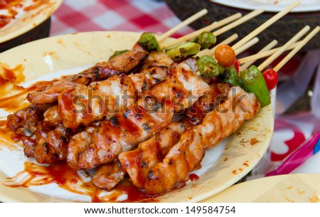 Barbecue with delicious grilled meat on dish - stock photo