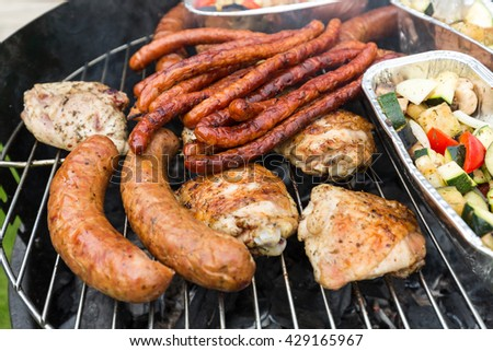 barbecue with delicious grilled meat on grill