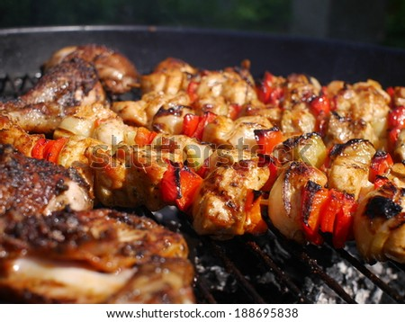 barbecue with  meat on metal grill - stock photo