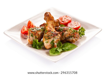Barbecued chicken drumsticks and vegetables  - stock photo