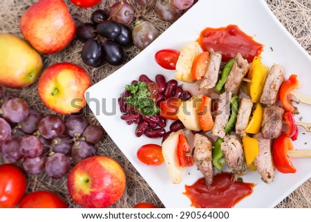 Barbecued pork placed in a white dish. - stock photo